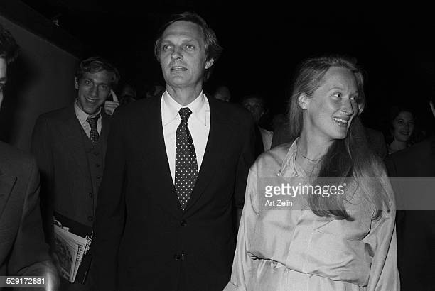 Meryl Streep with Alan Alda walking to an event circa 1970 New York