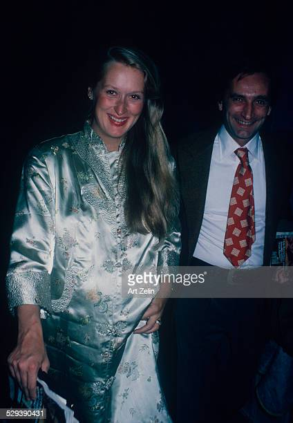 Meryl Streep with her husband Don Gummer She is pregnant wearing gray brocade circa 1970 New York