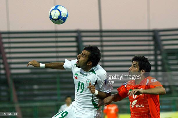 Mes Kerman's Pirooz Ghorbani challenges Zobahan's Mohammad Ghazi as he goes for a header during their AFC Champions League round of 16 football match...