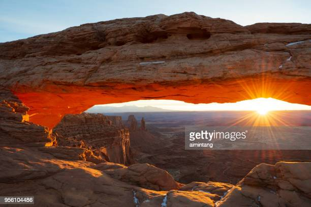 mesa arch at sunrise, canyonlands national park - mesa arch stock pictures, royalty-free photos & images
