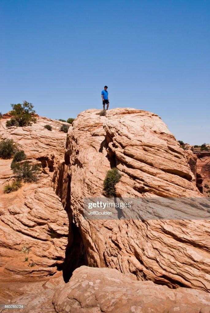 Walking Across Mesa Arch : Stock Photo