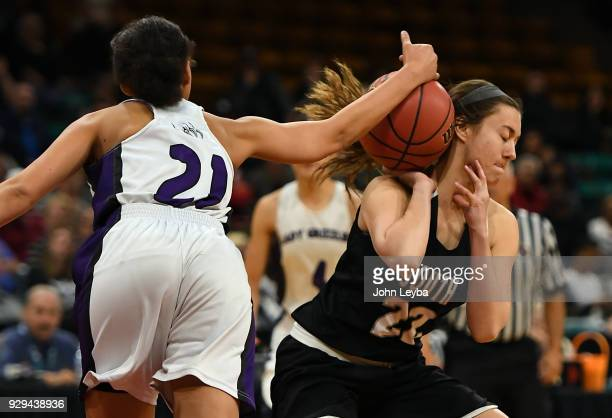 Mesa Ridge Angelina Jackson nocks the ball away from Pueblo South Brooke Crowell in the SemiFinal of the 2018 State Basketball Championships Final...