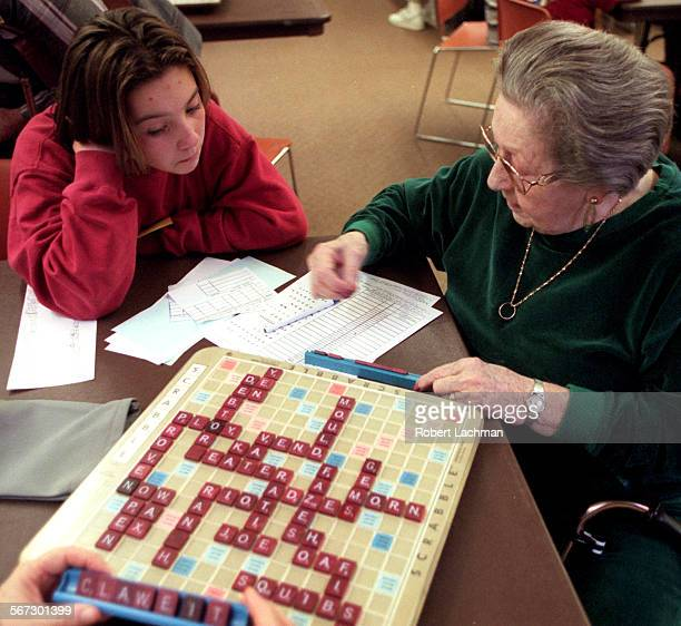 MEScrabbleGameRDL Bailey Norcross from Lomarena Elementary School in Laguna Hills watches Mercia Surfas of Laguna Hills play Scrabble at the Leisure...