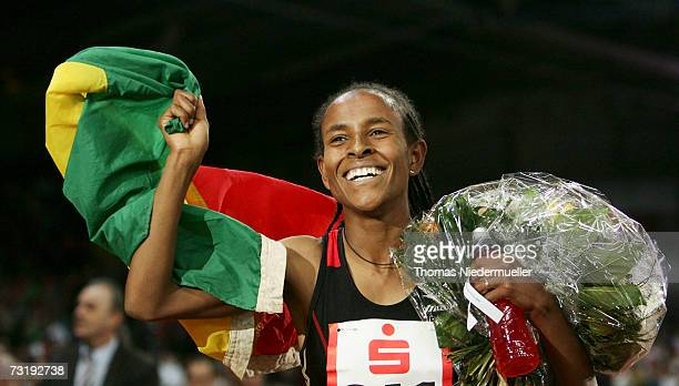 Meseret Defar of Ethiopia celebrates her indoor world record for the 3000m with a time of 82372 during the Sparkassen Cup 2007 at the HannsMartin...