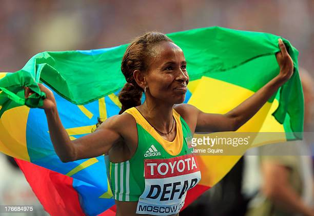 Meseret Defar of Ethiopia celebrates winning gold in the Women's 5000 metres final during Day Eight of the 14th IAAF World Athletics Championships...