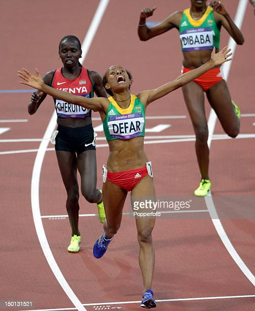 Meseret Defar of Ethiopia celebrates winning gold in the Women's 5000m Final on Day 14 of the London 2012 Olympic Games at Olympic Stadium on August...