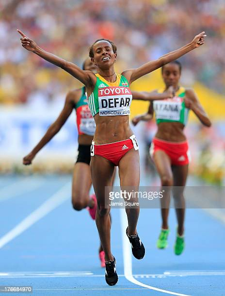 Meseret Defar of Ethiopia crosses the line to win gold in the Women's 5000 metres final during Day Eight of the 14th IAAF World Athletics...