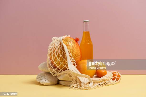 Mesh bag with fruit and soda