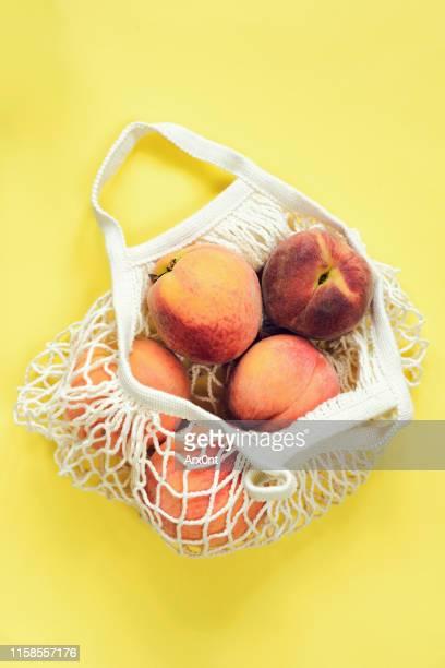Mesh shopping bag with peaches