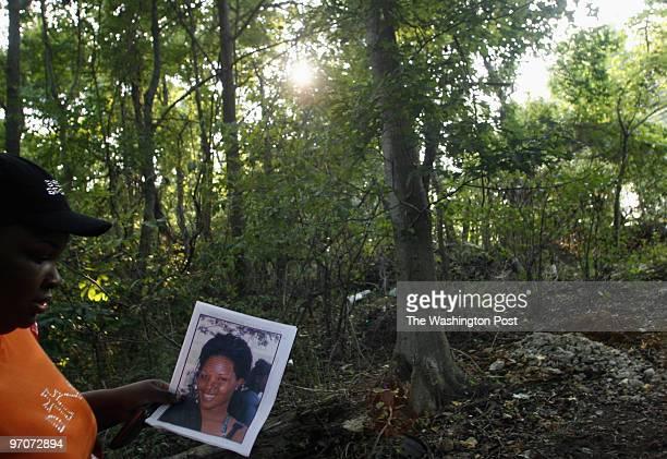 Shaquita DATE: August 28, 2007 CREDIT: Carol Guzy/ The Washington Post Fort Washington MD Lanitra McConnell, spiritual daughter of Shaquita's mother,...
