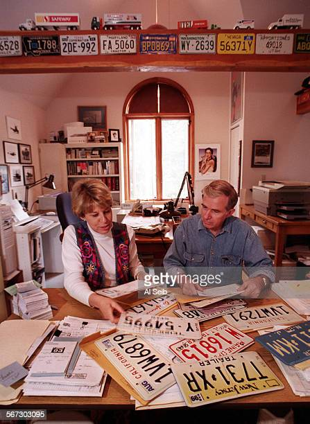 MESierra#10AS6–30–96A Georgetown CA Kris Anderson – Moore working with her husband Bill Moore as the pair run a vehicle registration service out of...