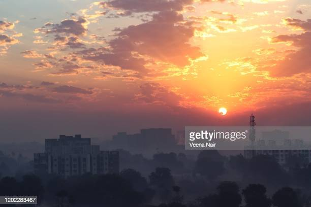 mesmerizing view of sky with beautiful clouds and sunrise - motera/ahmedabad - ahmedabad stock pictures, royalty-free photos & images