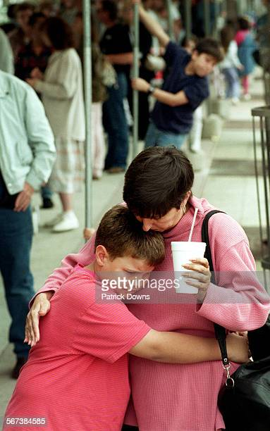 Chris Burger consoles her son Spenser age 8 as the family prepares go home giving up on getting into the Smithsonian exhibit They were photographed...