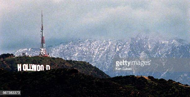 Snow.2/17/98.kl––BEVERLY HILLS––View of Hollywood sign backdropped by snow dusted San Gabriel Mountains Tuesday as seen from Beverly Hills civic...