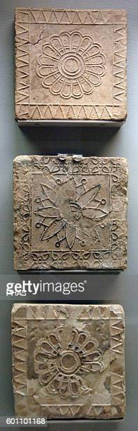 Mesopotamian Art Babylon Terracotta tiles decorated in floral motifs Dated between 600500 BC They come from the Temple of Nabu in Borsippa British...