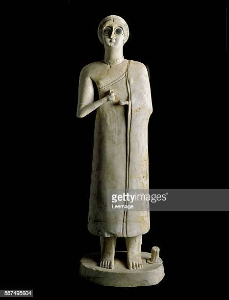 figure of a woman or goddess Terracotta 3rd millennium BC from Tell Asmar 59 cm Museum of Baghdad Iraq