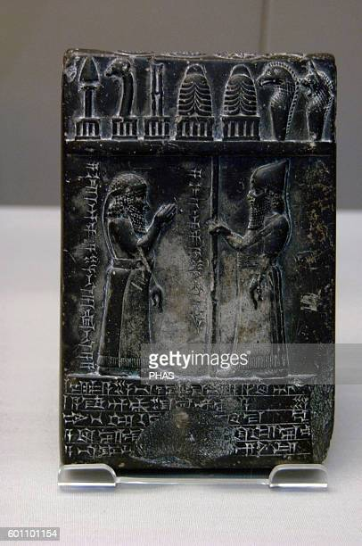 Mesopotamian Art Middle Babylonian 875850 BC Black diorite tablet carved with labelled scene showing Nabuaplaiddina the priest standing with his...
