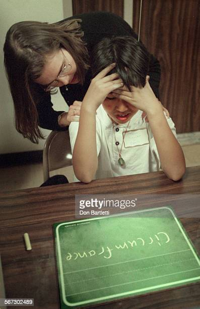 Spell.Lost.DB.f4/10/97.GardenGrove. Competing for one of the finalist places, Thinh Nguyen from Carrillo School is given a pat by a judge when he...