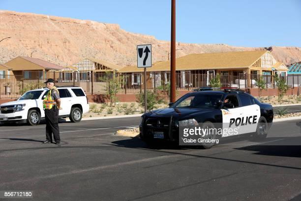 Mesquite Police Department citizen volunteer and a Mesquite Police car block access to the Sun City Mesquite community where suspected Las Vegas...