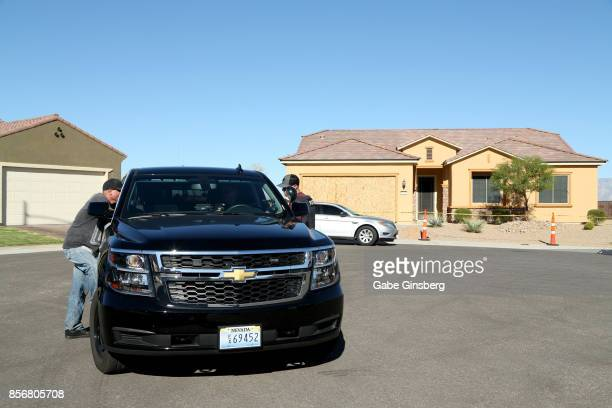 Mesquite Police offers talk in front of the house in the Sun City Mesquite community where suspected Las Vegas gunman Stephen Paddock lived October 2...