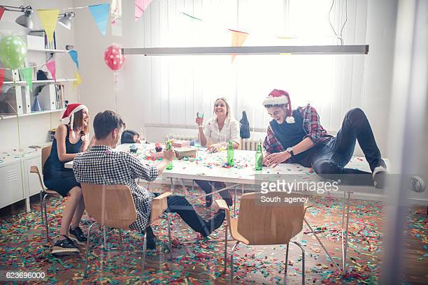 mess after a party in office - christmas after party stock pictures, royalty-free photos & images