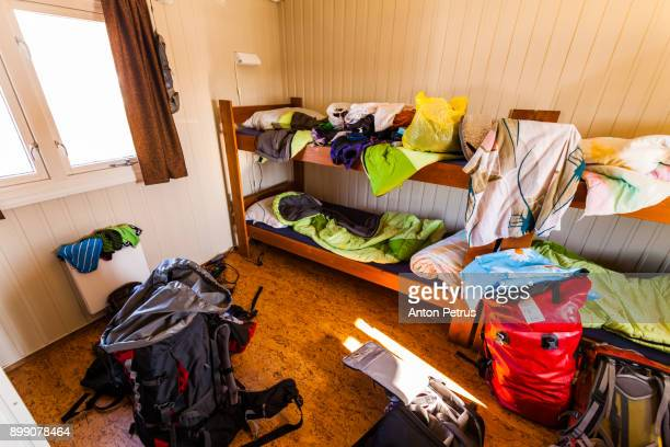 Mess in the hostel. Scattered things and backpacks