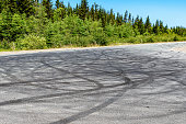many skid marks country road they