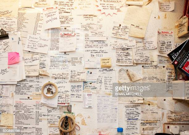 message board with many reminder notes - bulletin board stock pictures, royalty-free photos & images