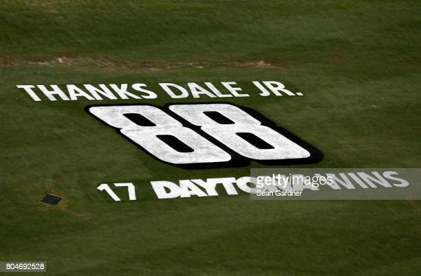 A message for Dale Earnhardt Jr driver of the Nationwide Chevrolet is seen painted on the infield grass prior to the NASCAR XFINITY Series CocaCola...