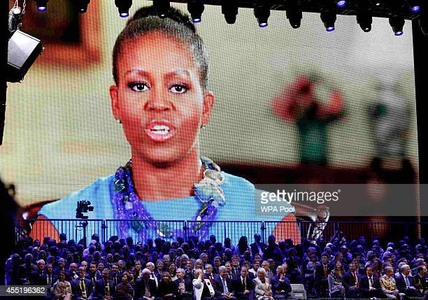 A message from US First Lady Michelle Obama is played on screen during the opening ceremony of the Invictus Games at the Queen Elizabeth Park on...