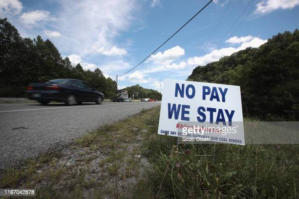 A message greets drivers as they approach a group of unemployed Blackjewel coal miners and their families blockading the railroad tracks that lead to...