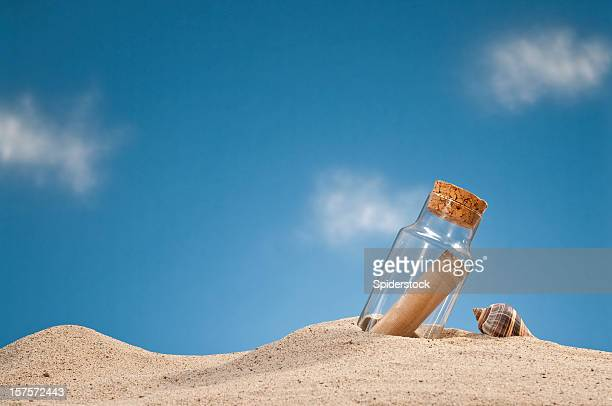 message in a bottle - buried stock pictures, royalty-free photos & images