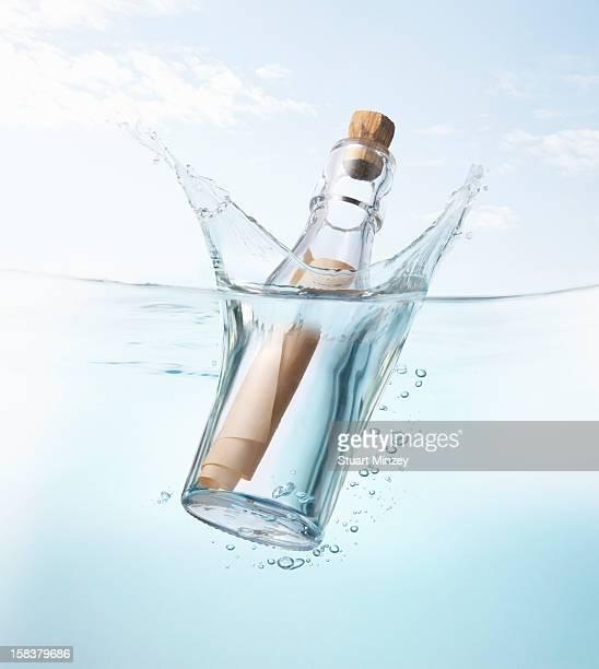 Message in a bottle splashing into water