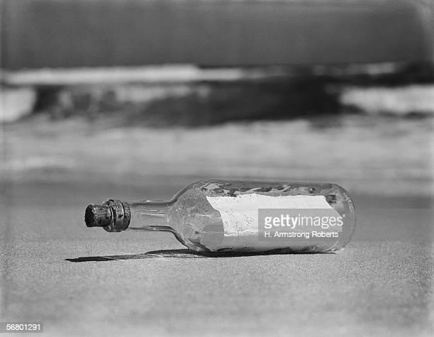 Message in bottle on shore