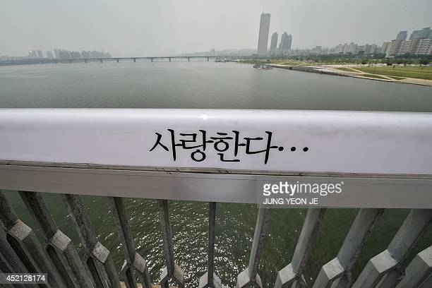 A message in Korean reading 'I Love You' is displayed along the railing to dissuade potential suicides on Mapo Bridge a common site for suicides over...
