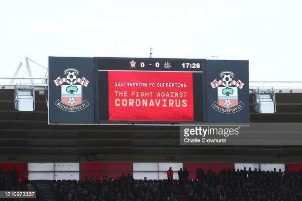 Message in regards to the Covid-19 virus is displayed on a LED screen inside the stadium during the Premier League match between Southampton FC and...