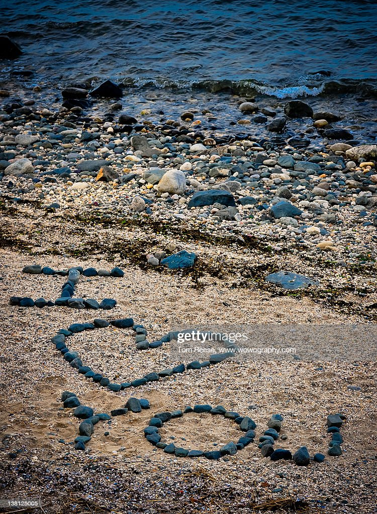 Message in sand on beach : Stock Photo