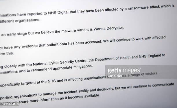 LONDON ENGLAND MAY A message informing visitors of a cyber attack is displayed on the NHS website on May 12 2017 in London England NHS hospitals...