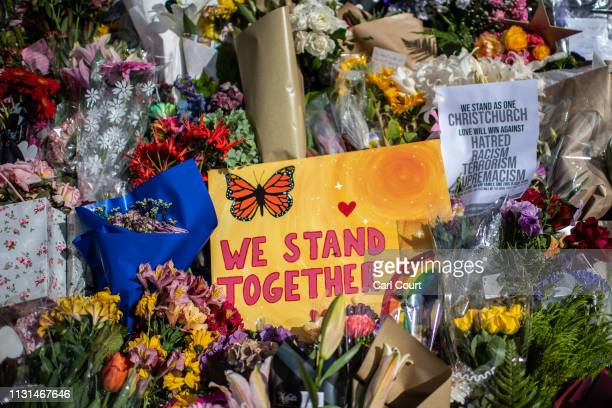 A message is left amongst flowers and tributes by the botanical gardens on March 19 2019 in Christchurch New Zealand 50 people were killed and dozens...