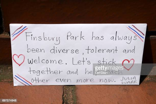 A message is left amongst flowers and tributes outside Finsbury Park mosque near the scene of a terror attack in Finsbury Park in the early hours of...