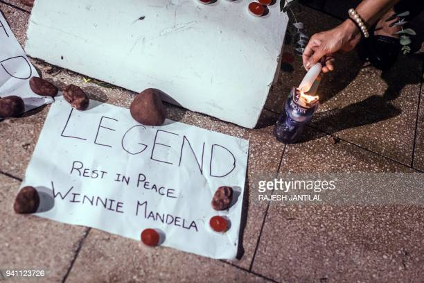 A message is left near the Old Durban Prison's Human Rights wall as South Africans gather to pay their respects to the late highprofile antiapartheid...
