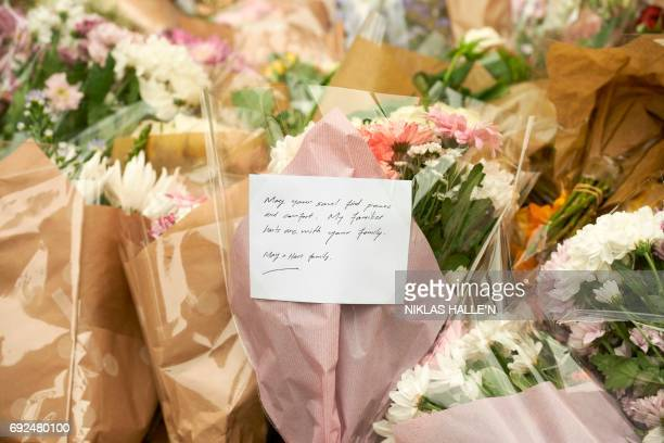 A message is pictured on a bouquet of flowers near Borough Market in London on June 5 left in tribute to the victims of the June 3 attacks British...