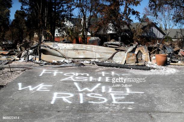 A message is written on driveway of a Coffey Park home that was destroyed by the Tubbs Fire on October 23 2017 in Santa Rosa California Residents are...