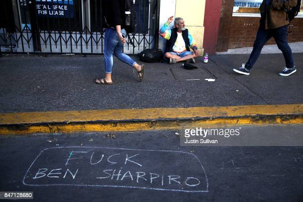 A message is written on the ground near the UC Berkeley campus on September 14 2017 in Berkeley California Police are out in force as protesters are...
