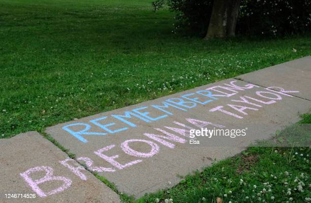 A message is written on the sidewalk along side the park where a candlelight vigil in memory of Breonna Taylor at Memorial Park on June 05 2020 in...