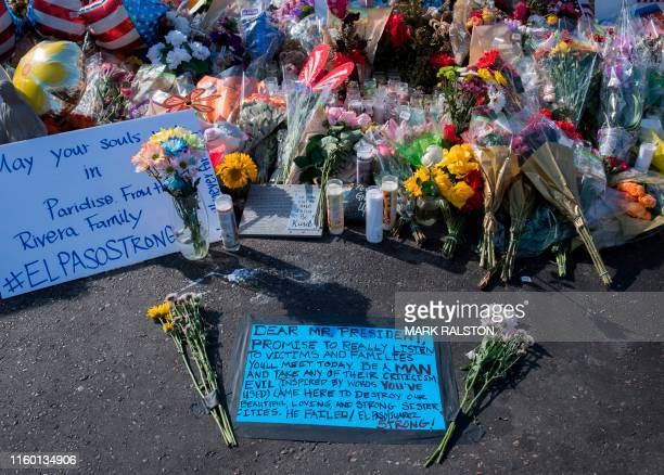 A message left for US President Trump before his August 7 visit adorns a makeshift memorial for victims of the shooting that left a total of 22...