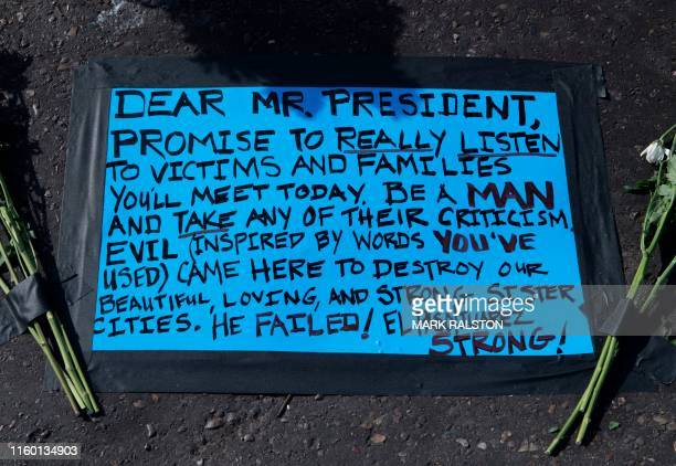 Message left for US President Trump before his August 7 visit at the makeshift memorial for victims of the shooting that left a total of 22 people...