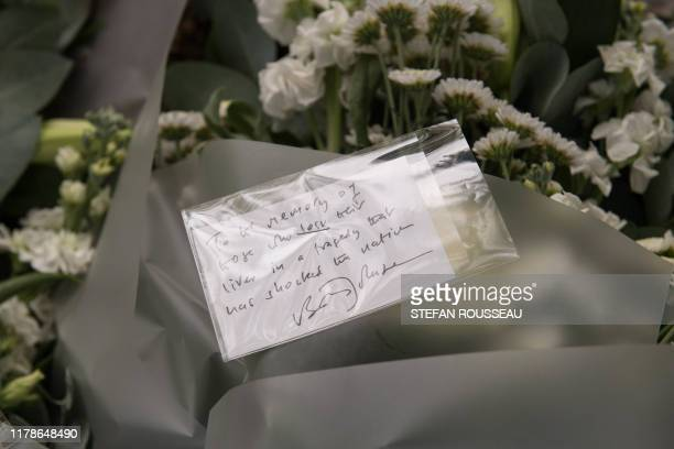 A message left on flowers laid by Britain's Prime Minister Boris Johnson is pictured during his visit to Thurrock Council Offices in Thurrock east of...
