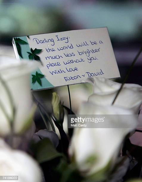 A message of condolence from Elton John and David Furnish is mounted among flowers at the funeral service for fashion stylist Isabella Blow at...