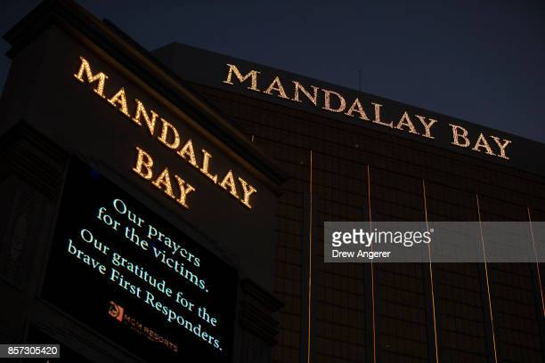 A message of condolences for the victims of Sunday night's mass shooting is displayed outside the Mandalay Bay Resort and Casino October 3 2017 in...